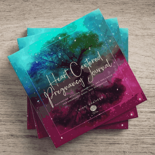A stack of Heart Centered Pregnancy Journal books